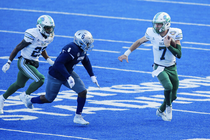 Tulane quarterback Michael Pratt (7) runs past Nevada defensive back Tyson Williams (6) on a scramble during the first half of the Idaho Potato Bowl NCAA college football game, Tuesday, Dec. 22, 2020, in Boise, Idaho. (AP Photo/Steve Conner)
