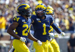 Michigan defensive back Lavert Hill (24) celebrates his interception with defensive back Ambry Thomas (1) in the third quarter of an NCAA football game against Army in Ann Arbor, Mich., Saturday, Sept. 7, 2019. Michigan won 24-21 in double-overtime. (AP Photo/Tony Ding)