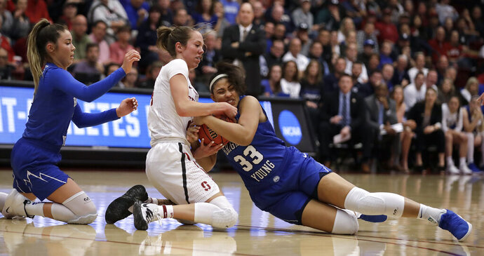 Stanford's Lacie Hull, center, fights for control of the ball with BYU forward Jasmine Moody (33) and BYU's Shaylee Gonzales, left, during the first half of a second-round game in the NCAA women's college basketball tournament Monday, March 25, 2019, in Stanford, Calif. (AP Photo/Ben Margot)