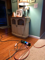 This Sunday, Oct. 6, 2019 photo provided by Kyla Awalt shows electrical cords winding around on the floor in a family house to provide electricity from a generator outside during Pacific Gas and Electric's shutoff in Paradise, Calif. When the nation's largest utility warned customers that it would cut power to nearly 2 million people across Northern California, many rushed out to buy portable generators, knowing the investment could help sustain them as blackouts became a recurring fact of life. Others had the security of knowing they could rely on solar panels and batteries installed in their homes when the lights went out. (Kyla Awalt via AP)