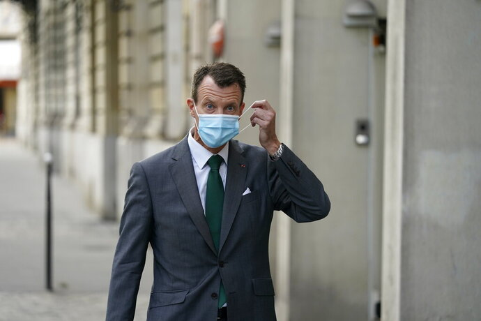 "Denmark's Prince Joachim adjusts his face mask as he walks to work, at the Danish Embassy in Paris, France, Friday, Sept. 18 2020. Prince Joachim, the younger son of Queen Margrethe of Denmark, who underwent an emergency surgery in France in July for a blood clot in his brain, says he is ""eager to get started"" as he arrived for his first work day at the Danish Embassy in Paris. The 51-year-old prince spoke to reporters outside the Danish mission where he will be defense attache. Joachim was rushed to the Toulouse University Hospital on July 24.  (Mads Claus Rasmussen/ Ritzau Scanpix via AP)"
