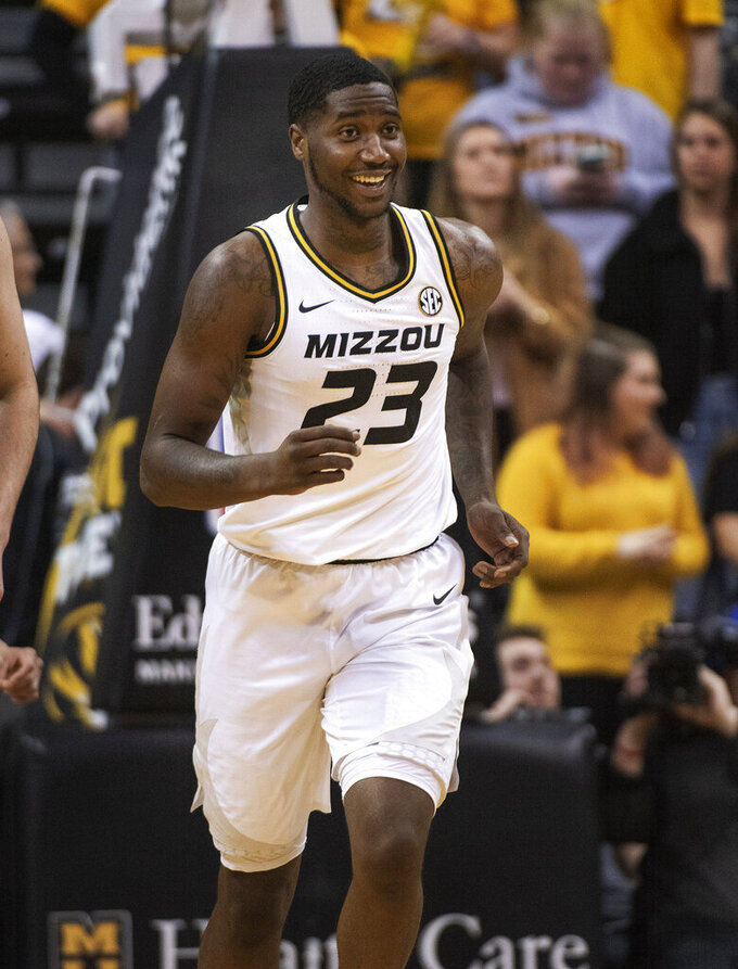 Missouri's Jeremiah Tilmon smiles as he runs up court during the first half of an NCAA college basketball game against South Carolina Saturday, March 2, 2019, in Columbia, Mo. Missouri won the game 78-63. (AP Photo/L.G. Patterson)