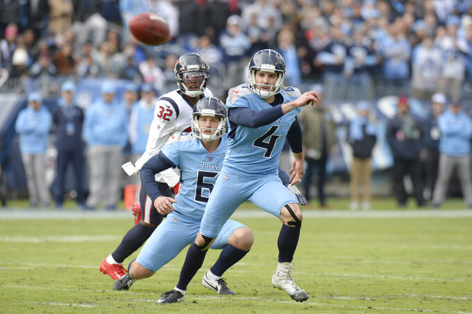 Tennessee Titans kicker Ryan Succop (4) and holder Brett Kern (6) chase after the ball after Succop's 45-yard field goal attempt was blocked by the Houston Texans in the first half of an NFL football game Sunday, Dec. 15, 2019, in Nashville, Tenn. (AP Photo/Mark Zaleski)