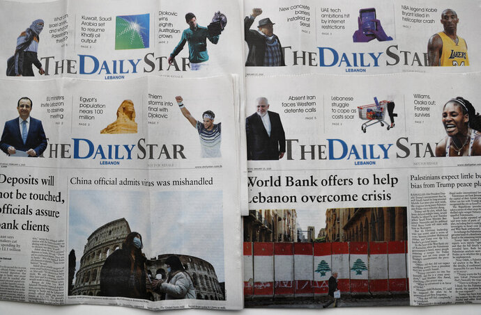 Recent editions of The Daily star newspaper are displayed, in Beirut, Lebanon, Tuesday, Feb. 4, 2020. Lebanon's only English-language newspaper has announced that it's temporarily suspending its print edition because of financial challenges as the country passes through its worst economic crisis in decades. The Daily Star said on Tuesday that its website and social media platforms will continue work as usual. (AP Photo/Hussein Malla)
