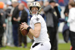 FILE - In this Dec. 22, 2019, file photo, New Orleans Saints quarterback Drew Brees warms up for the team's NFL football game against the Tennessee Titans in Nashville, Tenn. Between them, Tom Brady and Brees have played 38 pro football seasons, 39 if you count 2008 when the New England star wrecked his knee in Week 1,  and could be doing so against each other on Feb. 2 in a little thing called the Super Bowl. (AP Photo/Mark Zaleski, File)
