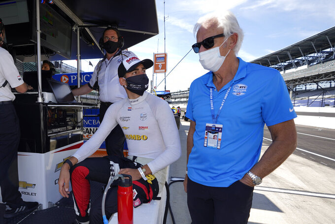 Rinus VeeKay, of the Netherlands, left foreground, talks with Arie Luyendyk before the final practice session for the Indianapolis 500 auto race at Indianapolis Motor Speedway, Friday, Aug. 21, 2020, in Indianapolis. (AP Photo/Darron Cummings)