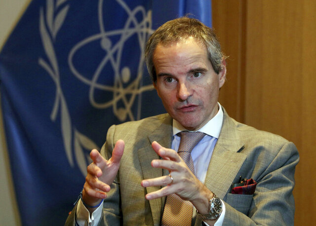 Director General of International Atomic Energy Agency (IAEA) Rafael Mariano Grossi from Argentina, gestures during an interview with The Associated Press at the International Center in Vienna, Austria, Tuesday, Dec. 3, 2019. The new head of the U.N.'s atomic watchdog agency says it still has not received the information it needs from Iran on the discovery of uranium particles of man-made origin at a site near Tehran that wasn't declared to the agency. (AP Photo/Ronald Zak)