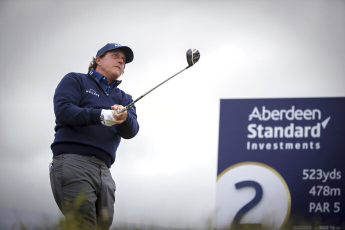 Phil Mickelson tees off at the 2nd, during day one of the Scottish Open golf tournament at Gullane Golf Club, East Lothian, Scotland, Thursday July 12, 2018.  Mickelson said Thursday, he wishes he could take back the moment when he swatted a moving golf ball at the U.S. Open. (Kenny Smith/PA via AP)