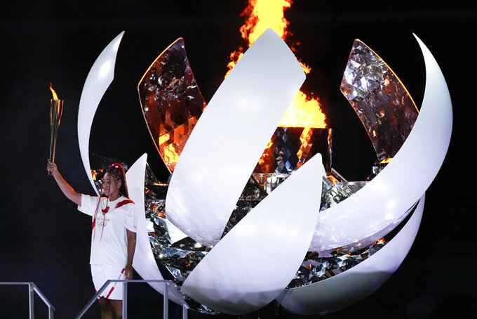 Japan's Naomi Osaka reacts after lighting the cauldron during the opening ceremony in the Olympic Stadium at the 2020 Summer Olympics, Friday, July 23, 2021, in Tokyo, Japan. (AP Photo/Ashley Landis)