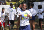 Ciayna Bailey, 13, of Wilmington, hits during drills in the Tennis Rocks Tutoring and Music Association's last day of its summer session for young people at Haynes Park, Thursday, Aug. 5, 2021, in Wilmington, Del. (William Bretzger/The News Journal via AP)