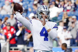 Dallas Cowboys quarterback Dak Prescott (4) warms up prior to an NFL football game against the New England Patriots, Sunday, Oct. 17, 2021, in Foxborough, Mass. (AP Photo/Steven Senne)