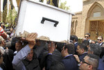 FILE - In this June 30, 2015 file photo, pall bearers carry the body of slain Egyptian Prosecutor General Hisham Barakat who was killed in bomb attack a day earlier, during his burial at a cemetery in Cairo. On Wednesday, Feb. 20, 2019 Egypt executed nine suspected Muslim Brotherhood members convicted of involvement in the 2015 assassination of Barakat, security officials said. The bombing that killed Barakat was the first assassination of a senior official in Egypt in a quarter century. (AP Photo/Ahmed Gamil, File)