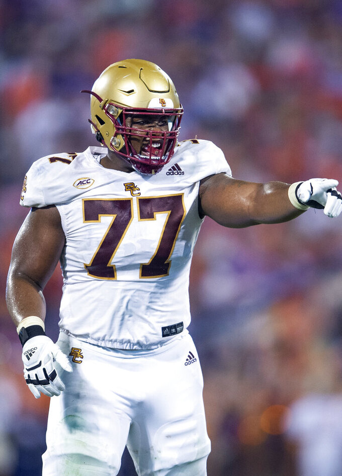Boston College offensive lineman Zion Johnson (77) points out a defense during the half of an NCAA college football game against Clemson Saturday, Oct. 2, 2021, in Clemson, S.C. (AP Photo/Hakim Wright Sr.)