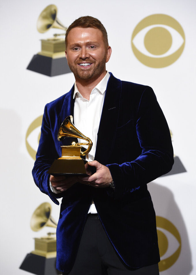 """FILE - This Feb. 10, 2019 file photo shows Shane McAnally, winner of the award for best country song for """"Space Cowboy"""" in the press room at the 61st annual Grammy Awards in Los Angeles. Songwriters are taking their writing sessions online during the pandemic, sometimes co-writing songs across continents.  McAnally said he prefers feeling the energy in a room with another writer and finds the sound quality on video calls to be lacking.. (Photo by Chris Pizzello/Invision/AP, File)"""