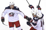 Columbus Blue Jackets defenseman Zach Werenski (8) celebrates his goal against the Toronto Maple Leafs with Boone Jenner (38) and Gustav Nyquist (14) during the first period of an NHL hockey playoff game Sunday, Aug. 9, 2020, in Toronto. (Nathan Denette/The Canadian Press via AP)