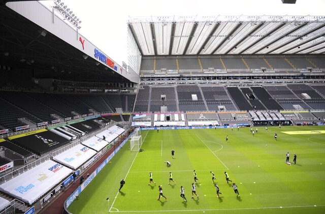 Players warm up before the English Premier League soccer match between Newcastle and Liverpool at St. James' Park in Newcastle, England, Sunday, July 26, 2020. (Laurence Griffiths, Pool via AP)