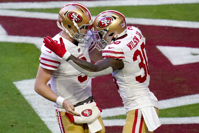 San Francisco 49ers running back Jeff Wilson (30) celebrates his touchdown against the Arizona Cardinals with quarterback C.J. Beathard (3) during the first half of an NFL football game, Saturday, Dec. 26, 2020, in Glendale, Ariz. (AP Photo/Ross D. Franklin)