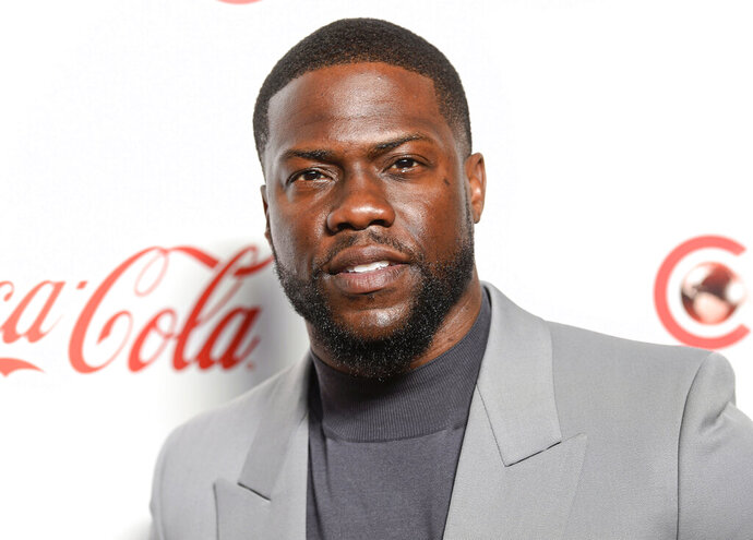 "FILE - In this April 4, 2019 file photo, Kevin Hart poses for photos at the Big Screen Achievement Awards at Caesars Palace in Las Vegas. Hart says his ""world was forever changed"" after he suffered a serious back injury when the vintage muscle car he was riding in crashed nearly two months ago in California. In a video posted Tuesday night, Oct. 29 on Instagram, the 40-year-old thanked his family and friends and reflected on how he sees life differently.(Photo by Chris Pizzello/Invision/AP, File)"