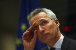NATO Secretary-General Jens Stoltenberg adjusts his glasses before addressing European Parliament Foreign Affairs committee members at the European Parliament in Brussels, Tuesday, Jan. 21, 2020. Stoltenberg told lawmakers that NATO needs to beef up its military training operation in Iraq once the government in Baghdad requests that it resume work. (AP Photo/Francisco Seco)