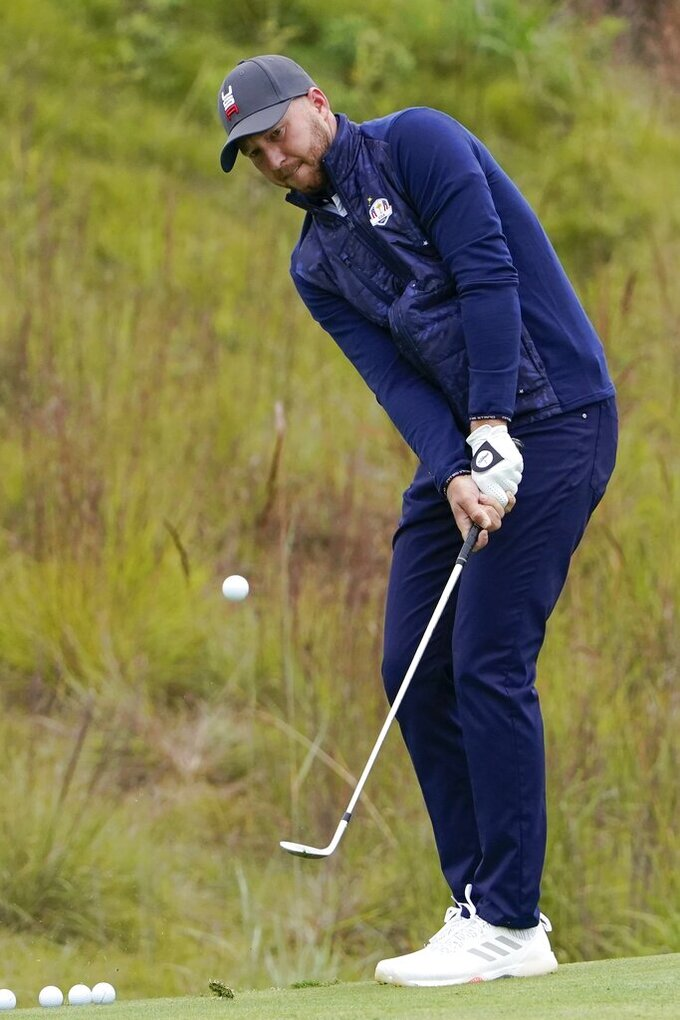 Team USA's Daniel Berger chips to a practice green during a practice day at the Ryder Cup at the Whistling Straits Golf Course Tuesday, Sept. 21, 2021, in Sheboygan, Wis. (AP Photo/Jeff Roberson)