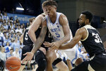 North Carolina's Armando Bacot (5) tries to control the ball against Wofford's Donovan Theme-Love (31) during the first half of an NCAA college basketball game in Carmichael Arena in Chapel Hill, N.C., Sunday, Dec. 15, 2019. (AP Photo/Chris Seward)