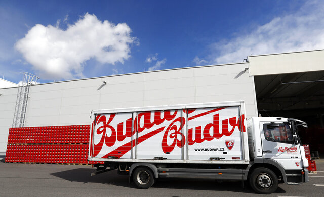 FILE - In this file photo taken Monday, March 11, 2019, a truck drives past cases of beer at the Budejovicky Budvar brewery in Ceske Budejovice, Czech Republic.  Budejovicky Budvar NP, a Czech state-owned brewery, said Wednesday June 24, 2020, that its output rose last year to the highest level in the brewer's 124-year history. (AP Photo/Petr David Josek, FILE)