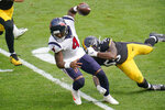 Houston Texans quarterback Deshaun Watson (4) tries to get past Pittsburgh Steelers inside linebacker Devin Bush (55) on a scramble during the first half of an NFL football game, Sunday, Sept. 27, 2020, in Pittsburgh. (AP Photo/Gene J. Puskar)