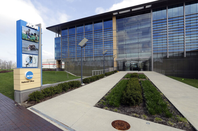 FILE - This is an April 25, 2018, file photo, showing NCAA headquarters in Indianapolis. As 2020 came to a close, there were at least 116 Division I programs at 34 schools slated for the chopping block, with that number expected to grow. A debate was brewing about whether there was a true financial need to drop the programs or if the schools were merely using the pandemic as a convenient excuse to make moves they'd wanted to make for a long time.   (AP Photo/Darron Cummings, File)