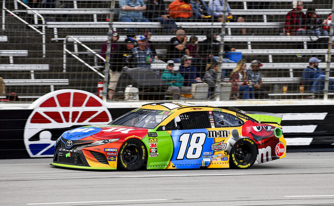 Kyle Busch (18) races down the front stretch during a NASCAR Cup Series auto race at Texas Motor Speedway, Sunday, Nov. 3, 2019, in Fort Worth, Texas. (AP Photo/Larry Papke)