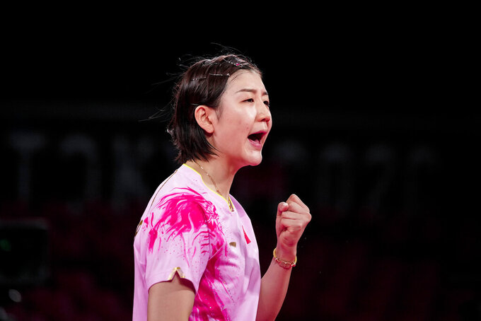 China's Chen Meng reacts during the table tennis women's singles semifinal against Singapore's Yu Mengyu at the 2020 Summer Olympics, Thursday, July 29, 2021, in Tokyo. (AP Photo/Kin Cheung)