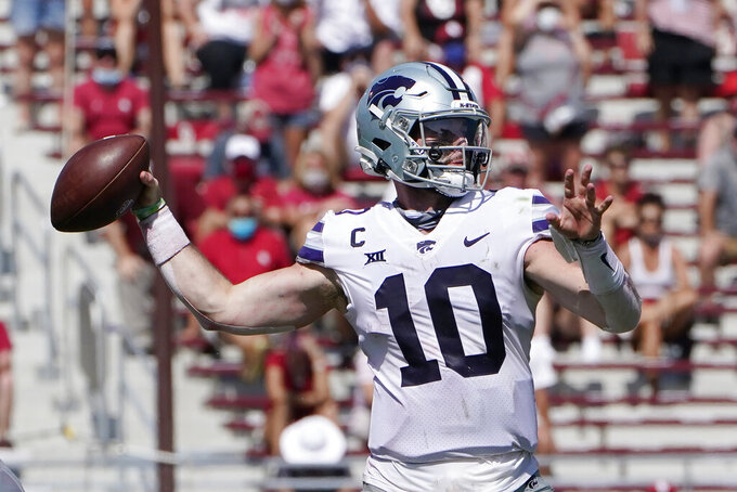 FILE - In this Sept. 26, 2020, file photo, Kansas State quarterback Skylar Thompson (10) throws a pass in the second half of an NCAA college football game against Oklahoma in Norman, Okla. (AP Photo/Sue Ogrocki, File)