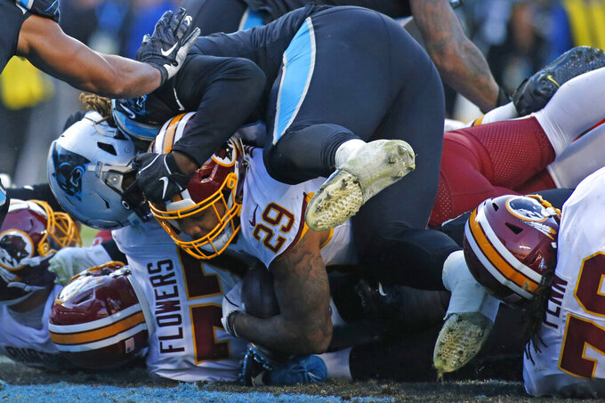 Washington Redskins running back Derrius Guice (29) scores a touchdown against the Carolina Panthers during the second half of an NFL football game in Charlotte, N.C., Sunday, Dec. 1, 2019. (AP Photo/Brian Blanco)