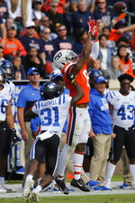 Virginia wide receiver Hasise Dubois (8) goes up for a pass as Duke cornerback Josh Blackwell (31) defends during the first half of an NCAA college football game in Charlottesville, Va., Saturday, Oct. 19, 2019. (AP Photo/Steve Helber)