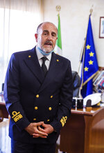 "In this picture taken on Thursday, May 21, 2020, Admiral Vincenzo Leone, head of the Lazio region Coast Guard, speaks during an interview with The Associated Press in Fiumicino, near Rome. ""This is a unique moment, that we hope will never happen again. In this moment most of the productive activities in the coastal towns and villages, stopped. The sea had something to tell us, we have listened to it and we are checking"