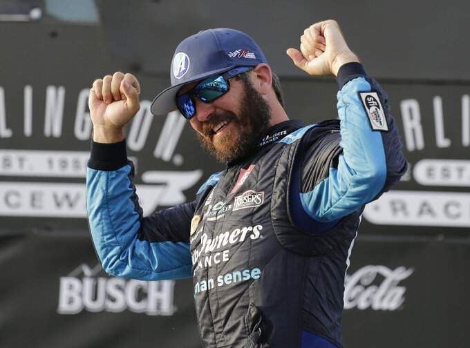 FILE - In this Sunday, May 9, 2021, file photo, Martin Truex Jr. celebrates in Victory Lane after winning the NASCAR Cup Series auto race at Darlington Raceway in Darlington, S.C. Truex starts on the pole at Dover a week after he took the checkered flag in a dominating drive at Darlington Raceway. (AP Photo/Terry Renna, File)