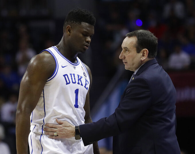 Duke head coach Mike Krzyzewski talks to Zion Williamson (1) during the first half of the NCAA college basketball championship game of the Atlantic Coast Conference tournament in Charlotte, N.C., Saturday, March 16, 2019. (AP Photo/Nell Redmond)