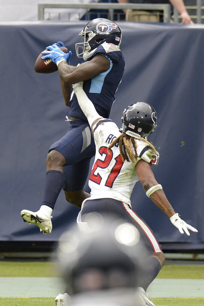 Tennessee Titans wide receiver A.J. Brown (11) catches a touchdown pass over Houston Texans cornerback Bradley Roby (21) in the second half of an NFL football game Sunday, Oct. 18, 2020, in Nashville, Tenn. (AP Photo/Mark Zaleski)