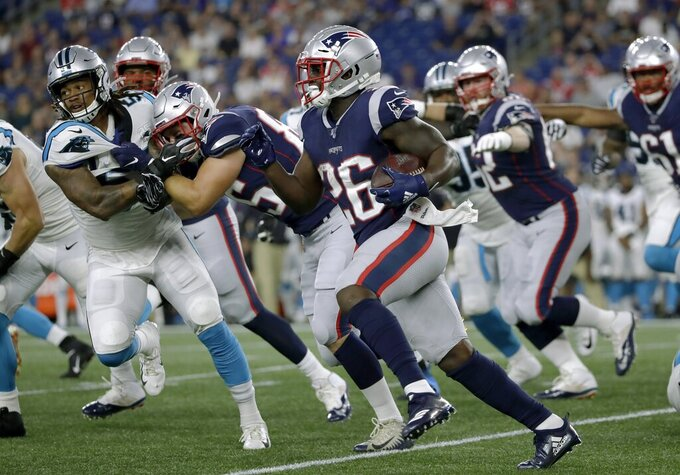 New England Patriots running back Sony Michel (26) gains yardage against the Carolina Panthers in the first quarter of an NFL preseason football game, Thursday, Aug. 22, 2019, in Foxborough, Mass. (AP Photo/Elise Amendola)