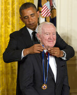 FILE - In this May 29, 2012 file photo, President Barack Obama awards former Supreme Court Justice John Paul Stevens the Presidential Medal of Freedom in the East Room of the White House, in Washington. Stevens, the bow-tied, independent-thinking, Republican-nominated justice who unexpectedly emerged as the Supreme Court's leading liberal, died Tuesday, July 16, 2019, in Fort Lauderdale, Fla., after suffering a stroke Monday. He was 99. (AP Photo/Carolyn Kaster, File)