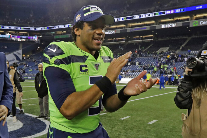 Seattle Seahawks quarterback Russell Wilson claps as he leaves the field after an NFL football game against the Minnesota Vikings, Monday, Dec. 2, 2019, in Seattle. The Seahawks won 37-30. (AP Photo/Ted S. Warren)