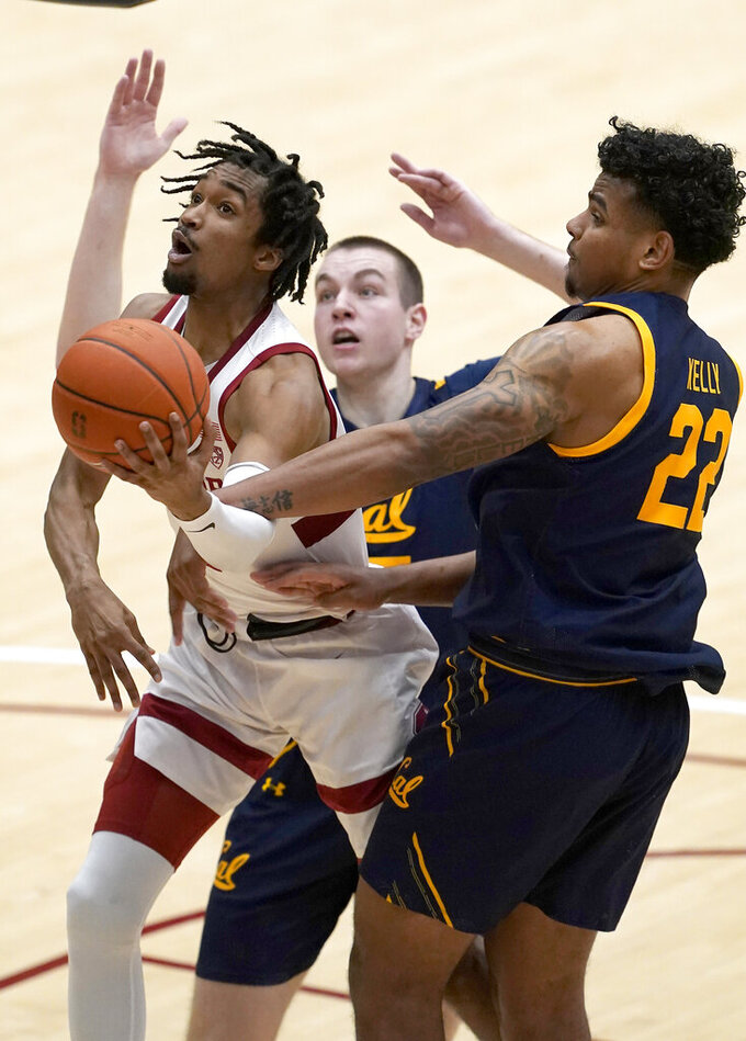 Stanford guard Bryce Wills, left, is fouled driving to the basket by California forward Andre Kelly (22) and forward Grant Anticevich, center, during the second half of an NCAA college basketball game in Stanford, Calif., Sunday, Feb. 7, 2021. (AP Photo/Tony Avelar)