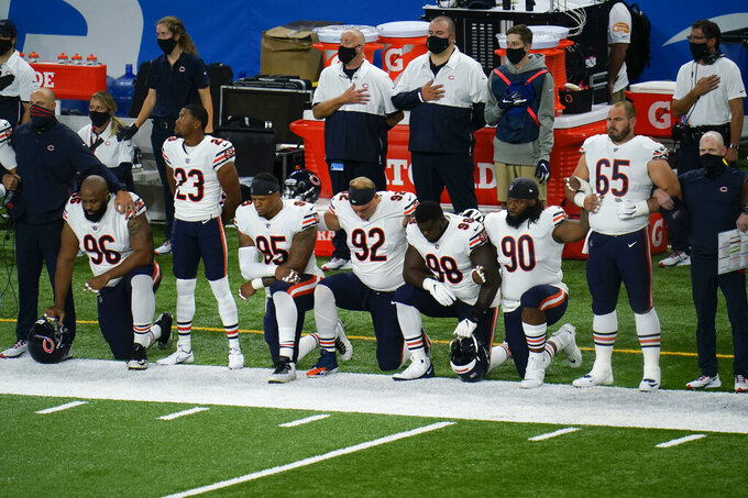 Chicago Bears' Akiem Hicks (96); Kyle Fuller (23); Roy Robertson-Harris (95), Brent Urban (92); Bilal Nichols (98); John Jenkins (90) and Cody Whitehair (65) listen during the national anthem before an NFL football game against the Detroit Lions in Detroit, Sunday, Sept. 13, 2020. (AP Photo/Paul Sancya)