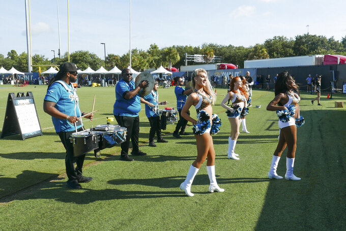 Jacksonville Jaguars cheerleaders perform for fans along with the team drum line during NFL football practice, Saturday, July 31, 2021, in Jacksonville, Fla. (AP Photo/John Raoux)