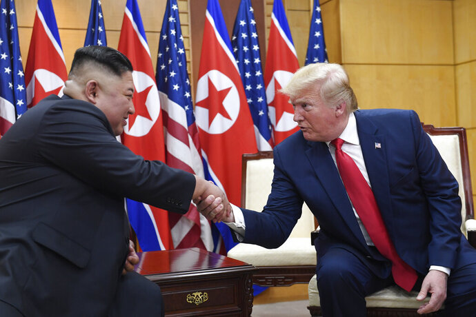 "FILE - In this June 30, 2019, file photo, President Donald Trump meets with North Korean leader Kim Jong Un at the border village of Panmunjom in the Demilitarized Zone, South Korea. North Korea said Monday diplomatic talks with the United States could resume in a ""few weeks,"" but it will not consider abandoning its nuclear weapons unless external threats are fully removed. (AP Photo/Susan Walsh, File)"