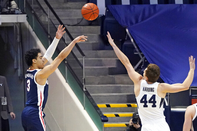 Gonzaga guard Andrew Nembhard (3) shoots as BYU guard Connor Harding (44) defends in the first half of an NCAA college basketball game, Monday, Feb. 8, 2021, in Provo, Utah. (AP Photo/Rick Bowmer)