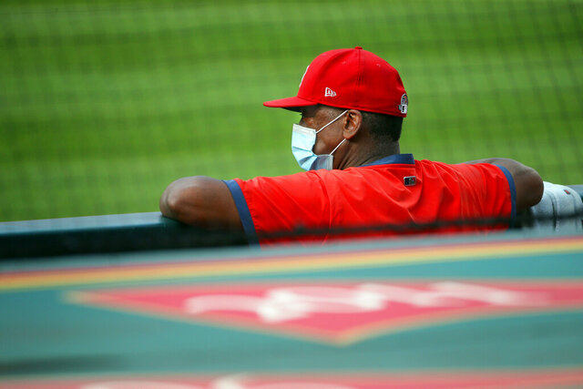 St. Louis Cardinals instructor and former player Willie McGee watches workouts on Tuesday, July 7, 2020, during summer camp training at Busch Stadium in St. Louis, for the upcoming shortened season. McGee has opted out of being with the team for the rest of the season while Major League Baseball announced Friday, Aug. 14, 2020, several doubleheaders to make up for games St. Louis has missed because of the coronavirus. (Christian Gooden/St. Louis Post-Dispatch via AP)