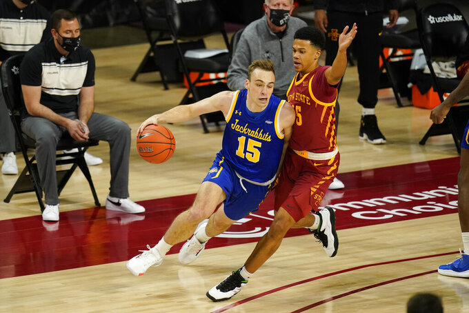 South Dakota State guard Noah Freidel (15) drives around Iowa State guard Rasir Bolton during the first half of an NCAA college basketball game, Wednesday, Dec. 2, 2020, in Ames, Iowa. (AP Photo/Charlie Neibergall)