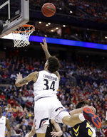 Cincinnati's Jarron Cumberland (34) drives to the basket against Iowa's Luka Garza (55) in the first half during a first round men's college basketball game in the NCAA Tournament in Columbus, Ohio, Friday, March 22, 2019. (AP Photo/Tony Dejak)