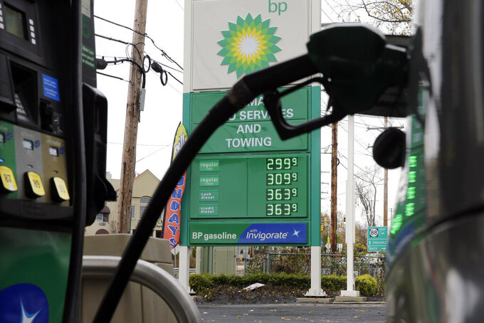 """FILE - In this file photo dated Tuesday, Nov. 12, 2013, a sign at a BP filling station in Lakewood, N.J., USA.  Energy company BP said Tuesday April 27, 2021, it will be returning around half a billion dollars to shareholders after """"significantly"""".  (AP Photo/Mel Evans, FILE)"""