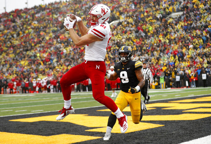 Nebraska wide receiver Kade Warner catches a two-point conversion pass in front of Iowa defensive back Geno Stone (9) during the second half of an NCAA college football game, Friday, Nov. 23, 2018, in Iowa City, Iowa. Iowa won 31-28. (AP Photo/Charlie Neibergall)